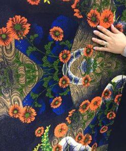 Material textil pret